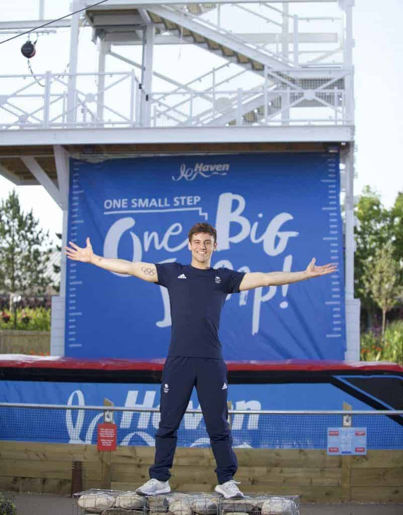 Tom Daley in front of banner printed by Fantasy Prints